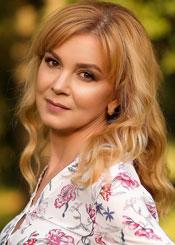 Olesya, (43), de Europa del Este es soltera